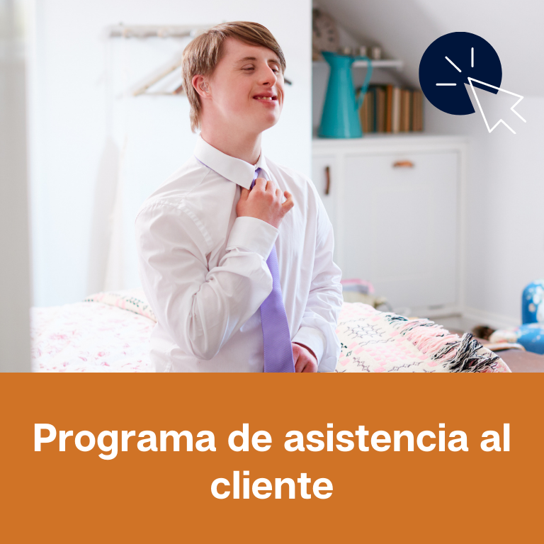 """Photo of a white, young adult man in a room sitting on a bed. He is wearing a white button down shirt and a purple tie. He is adjusting his tie. He is smiling. Below the image is an orange rectangle with white text that reads: """"Programa de asistencia al cliente."""" In the upper right hand corner of the image is an icon of a white computer mouse inside of a navy blue circle."""