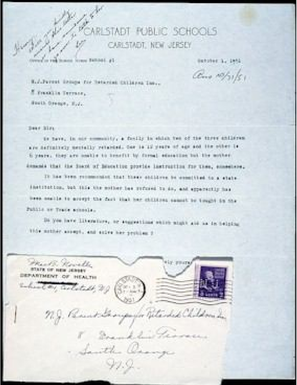 """Picture of an old letter with the title CARLSDT PUBLIC SCHOOLS."""" There is unreadable cursive handwriting in the upper right hand corner. A letter is written but the words are blurry. Underneath is an envelope that has been ripped open with a navy blue stamp in the upper right. It is addressed with cursive handwriting."""
