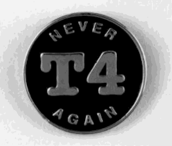 """Black and white image of a black circular pin. In metal writing, it reads """"NEVER T4 AGAIN."""" The """"T4"""" is the biggest part and is centered."""