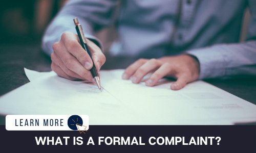 """Image of a man's hands signing a document with a pen. Below the image is a black box with white text reading """"WHAT IS A FORMAL COMPLAINT?"""". To the left is a white box with dark blue text reading """"LEARN MORE"""" with and orange and blue cursor icon graphic to the right."""